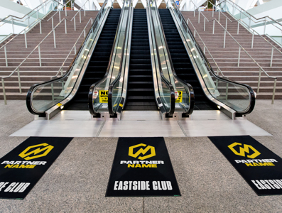 Three escalators, viewed from the bottom