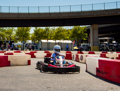 A go-cart course with driver in helmet.
