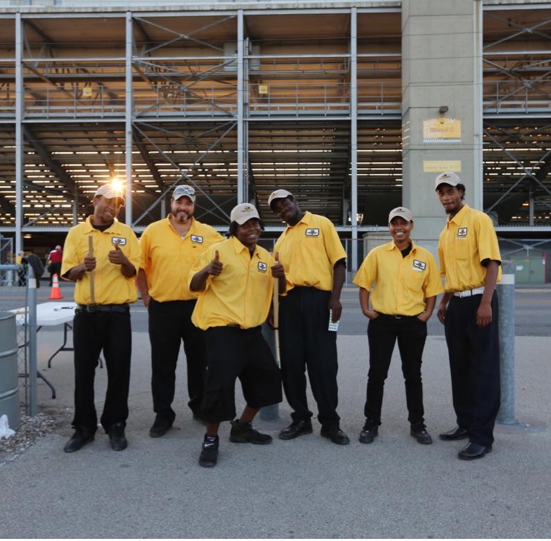 Group of Volunteers in uniform, smiling.